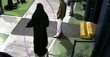Police handout taken from CCTV footage of July 21 London bomb suspect Yassin Omar dressed in a burka at Digbeth coach station in Birmingham