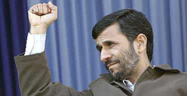President Mahmoud Ahmadinejad clenches his fist, during a public gathering in the city of Rasht, Iran