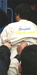 Egyptian blogger Abdel Kareem Nabil is escorted from court in Alexandria