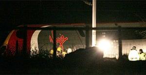 Emergency services investigate the derailed Virgin Pendolino train in Cumbria