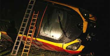 The derailed Virgin train lies in a field near the village of Grayrigg in the Lake District