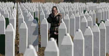 A Bosnian-Muslim man says a prayer at the memorial centre of Potocari, near Srebrenica