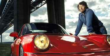 Author Iain Banks with one of his Porsches