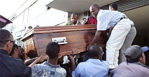 Pallbearers carry the coffin of Muhammad Jamal Khalifa at Ivato airport in Antananarivo, in Madagascar