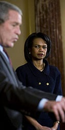 The US secretary of state, Condoleezza Rice, watches president George Bush speak during a swearing-in ceremony for the deputy secretary of state, John Negroponte, in Washington.