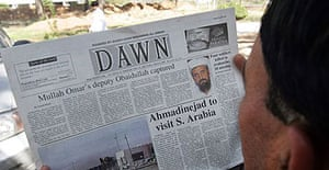 A Pakistani man reads about the arrest of the top Taliban leader. Mullah Obaidullah Akhund, in a newspaper in Islamabad.