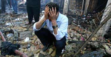 Muhammad Salman grieves yesterday at the scene of his brother's death in Monday's car bomb blast in central Baghdad