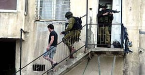 Sameh Amira is escorted by heavily armed Israeli soldiers on a door-to-door sweep in Nablus, providing some of the strongest evidence to date that the Israeli army is still using Palestinian civilians as human shields
