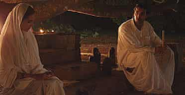 Lisa Ray and John Abraham star in Water, directed by Deepa Mehta.