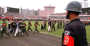 Police parade prisoners awaiting execution at rally in south-western China