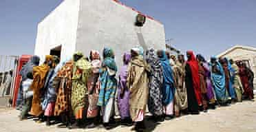Displaced Sudanese women queue for a medical checkup at a Red Crescent hospital in the Darfur city of Nyala.