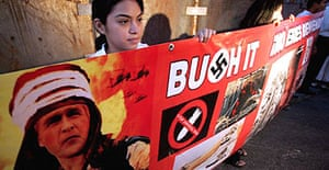 Mexican protesters hold an anti-George Bush banner