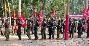 Maoist rebels march during their ninth convention at an undisclosed location in the jungles of Indian state of Chattisgarh