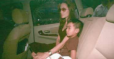 Angelina Jolie with her adopted son Maddox, from Cambodia, as she leaves Tam Binh orphanage in Ho Chi Minh City, where she adopted a three-year-old Vietnamese boy. Photograph: AP