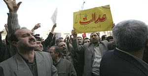 Iranian teachers take part in a protest over pay in front of the parliament building in Tehran