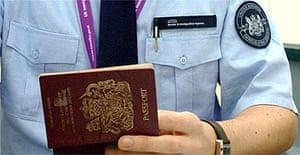 Immigration officer checks a British passport
