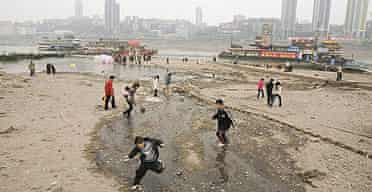 Locals walk on a nearly dried-up area of the Yangtze river in the Chinese city of Chongqing.