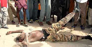 The body of a Somali soldier killed in heavy fighting in Mogadishu is dragged through the city's streets