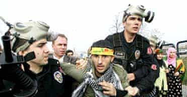 A Kurd is arrested at an Istanbul rally on Wednesday