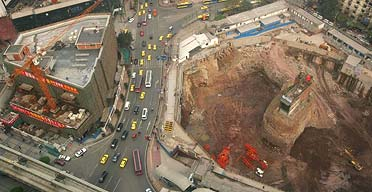 Yang Wu and Wu Ping's house stands isolated on a mound in the middle of a construction site in Chongqing, south-west China