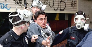 Turkish riot police detain a Kurdish demonstrator during Noruz celebrations to mark the coming of spring in Istanbul