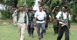 The former Tamil Tiger commander Colonel Karuna with his bodyguards