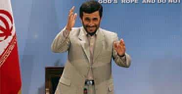 Iranian president Mahmoud Ahmadinejad arrives at a press conference in Tehran