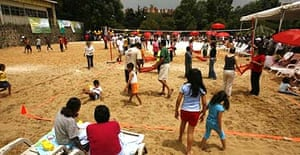 People enjoy the sand during the opening day of Mexico City's first of four city beaches