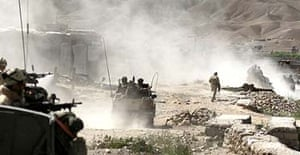 British and American troops defend Sangin, the Helmand town vacated by Taliban fighters last week