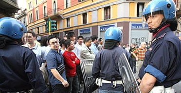 Italian riot police patrol Milan's Chinatown following clashes with local residents over a parking ticket