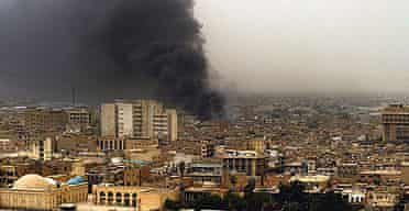 Thick smoke billows from the site of an explosion in central Baghdad, Iraq.