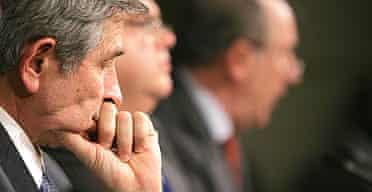 Paul Wolfowitz attends a press conference with other senior officials at the World Bank