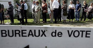 People wait in line to vote in the presidential elections in Pau, southern France.