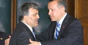 Turkish foreign minister Abdullah Gul, left, and the prime minister, Recep Tayyip Erdogan, embrace