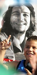 A young boy at May 1 celebrations in Havana stands in front of a poster of the revolutionary Ernesto 'Che' Guevara