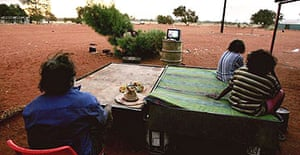 Aborigines watch television at an outstation in the Utopia community, Australia