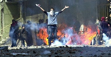 Turkish demonstrators set barricades on fire during clashes with riot police during a May Day rally in central Istanbul