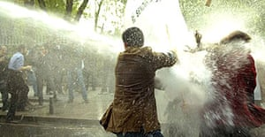 Turkish riot police use water cannon against protesters during clashes at a May Day rally in Istanbul's Taksim square ahead of a major protest against the ruling AK party