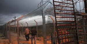Palestinians cross the Israeli army's Hawara checkpoint near the West Bank city of Nablus