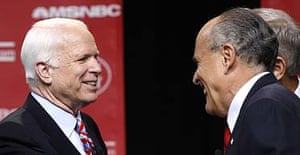 John McCain and Rudy Giuliani greet each other after the first Republican primary debate