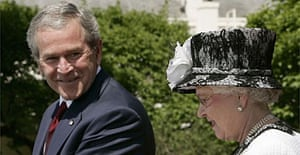 George Bush looks over at the Queen while making a speech at the White House during her state visit to the US
