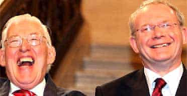 Northern Ireland's first minister, Ian Paisley, and the deputy first minister, Martin McGuinness, smile after being sworn in at Stormont. Photograph: Paul Faith/AP