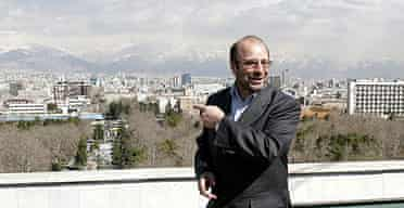 Tehran's mayor, Mohammad Bagher Qalibaf, walks on the roof of the municipality building in the Iranian capital.