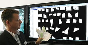 Jan Schneider of Germany's Fraunhofer-Institute demonstrates their latest software designed to reconstruct Stasi files