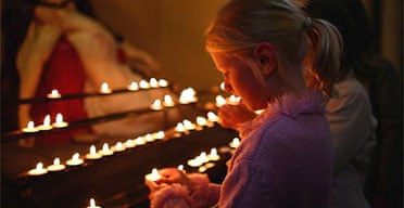 Young girls light candles as friends and family of the parents of missing toddler Madeleine McCann hold a vigil and prayer service in Glasgow