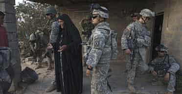 US soldiers from the 10th mountain division on a foot patrol in the so-called 'triangle of death' south of Baghdad