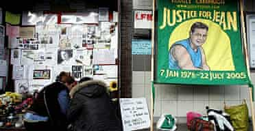 Visitors kneel in front of a memorial to Jean Charles de Menezes outside Stockwell tube station in south London.
