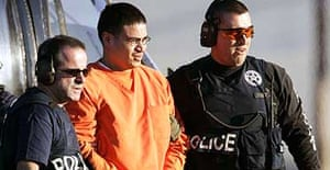 Alleged al-Qaida operative Jose Padilla (centre) was brought to Miami by federal marshalls in January 2006.