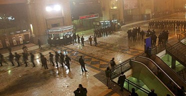 Riot police restore order at a Buenos Aires railway station after clashes with angry passengers. Photograph: AP/DyN/Tony Gomez