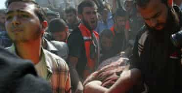 Palestinians rush wounded people to a hospital